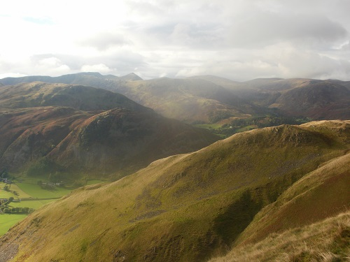 A range of hills including Helvellyn and the pointy summit of Catstycam
