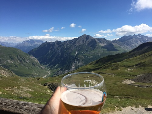 Enjoying a beer with a view from the Refuge de la Croix du Bonhomme